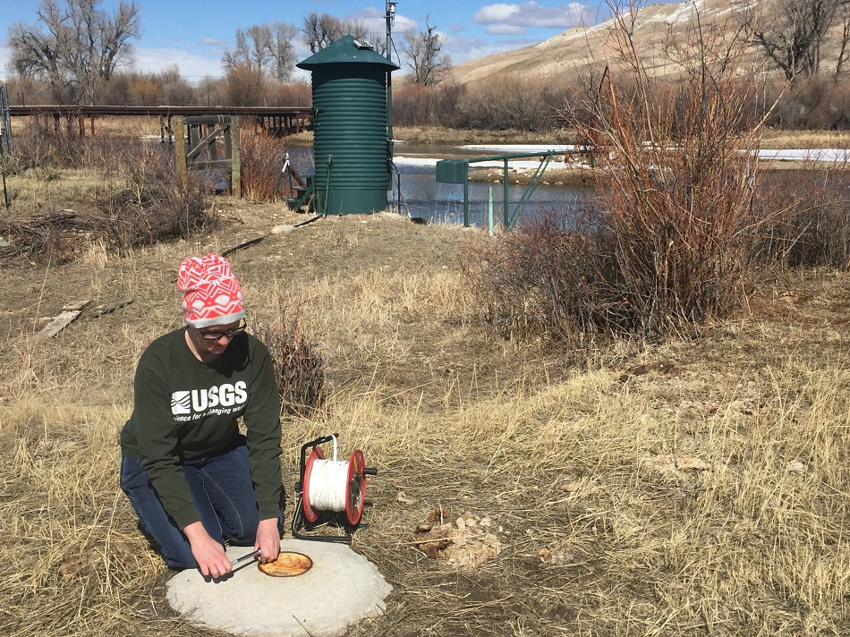 USGS hydrologist prepares to measure groundwater streamgage