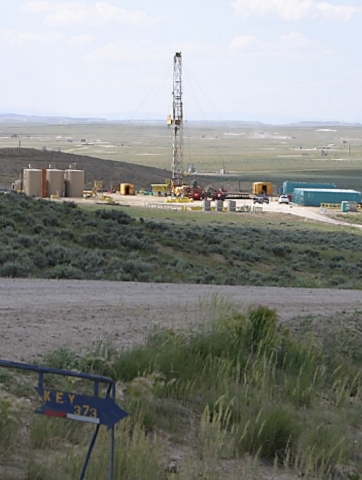 Photo of gas well and supporting infrastructure